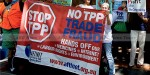 Protestors rally outside the TPP talks in Sheraton Hotel Sydney as global trade ministers discuss the Trans-Pacific Partnership (TPP) free-trade agreement on 25 October 2014