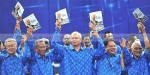 During a Barisan Nasional rally at a stadium in Bukit Jalil, Najib holds a copy of his coalition's election manifesto ahead of upcoming polls