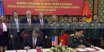 Secretary of Defense Ash Carter and the Vietnamese Minister of Defense General Phung Quang Thanh, sign a joint vision statement after meeting at the Vietnamese Ministry of Defense in Hanoi