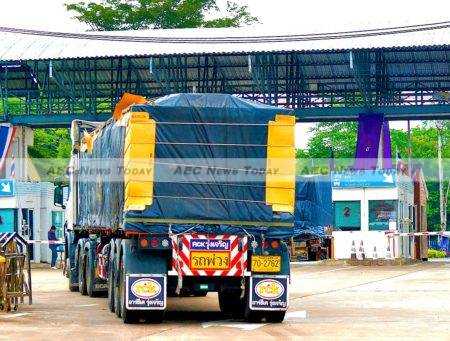 Laos relies heavily on foreign markets and ports. A truck prepares to cross from Thailand into Laos PDR