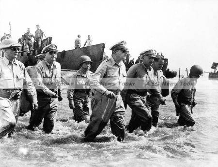 American forces are again returning to the Philippines. Here General MacArthur returns with Philippine president Sergio Osmena on October 1, 1944.
