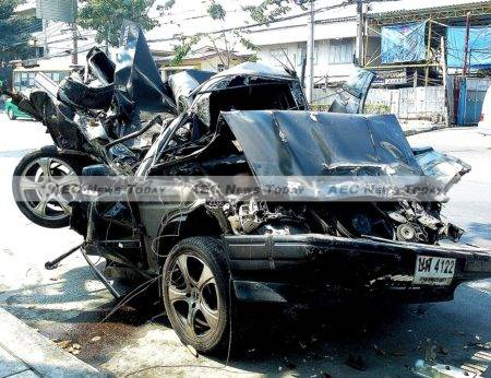 A destroyed Volvo sits on a Bangkok roadway, a casualty of Thailand's deadly roads