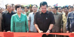 Cambodian Prime Minister Hun Sen (Front) cuts the ribbon to inaugurate a China-funded 1.73km (1.3 mile) bridge across the Mekong River and a 143km (85.86 mile) section of road in Stung Treng province, Cambodia, April 1, 2015.