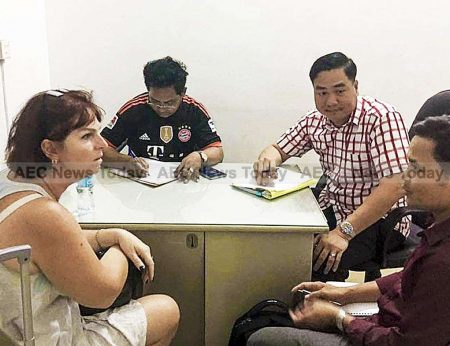File photo: Tammy Davis-Charles is interviewed by Cambodia officials last November
