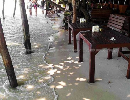 Beachgoers flee from rising sea water on Koh Sama, Thailand. Rising sea levels are set to have a significant impact on Thailand's 'tourist islands'
