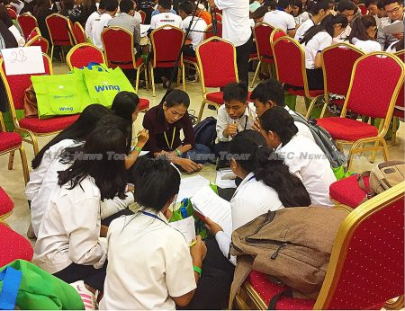 Participants in the entrepreneurship seminar participate in a small group workshop as part of the bid for a Guinness World Record for the largest practical business seminar