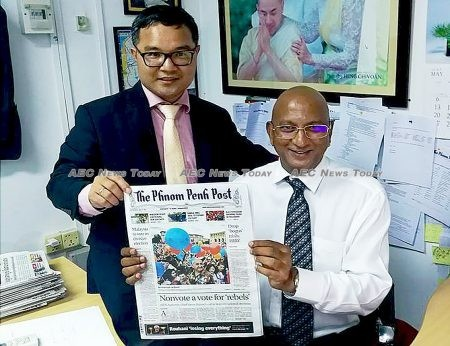Editor-in-chief Joshua Purushotman with now CEO and Publisher Ly Tayseng and the May 10 print edition of the English-language edition produced despite mass resignations by Western journalists on May 9.