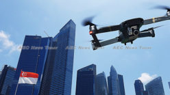 Drones, robots, and flying machines: the automation of Singapore (video)