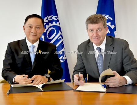 Thailand Minister of Labour, Police General Adul Sangsingkeo, and ILO director-general Guy Ryder ratifiy the Convention providing improved conditions for Thai fishers