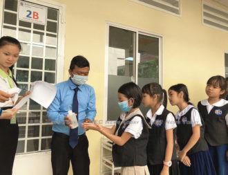 Cambodian students practice coronavirus hygiene