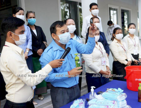 School students in Cambodia are shown the correct hand hygiene and barrier protection methods to help prevent the spread of Wuhan coronavirus