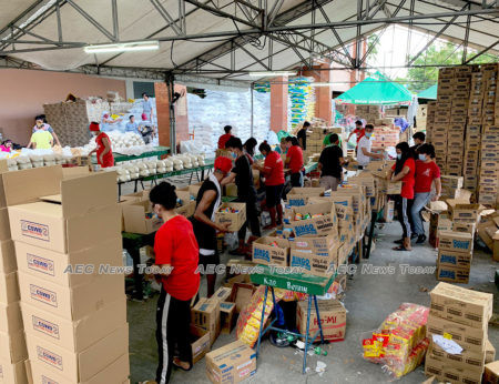 Food for distribution to the poor being packed by Bagong Kaunlaran HOAI-Paso de blas volunteers in the Philippines