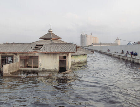 A mosque outside the sea wall in Muara Baru, North Jakarta abandoned due to flooding resulting from massive groundwater extraction