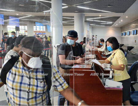 Barrier protection and PPE protect travellers and ground staff at Phnom Penh International Airport