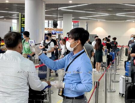 Temperature screening at Phnom Penh International Airport pre-departure check-in